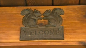 'welcome' plaque click to tiny home video