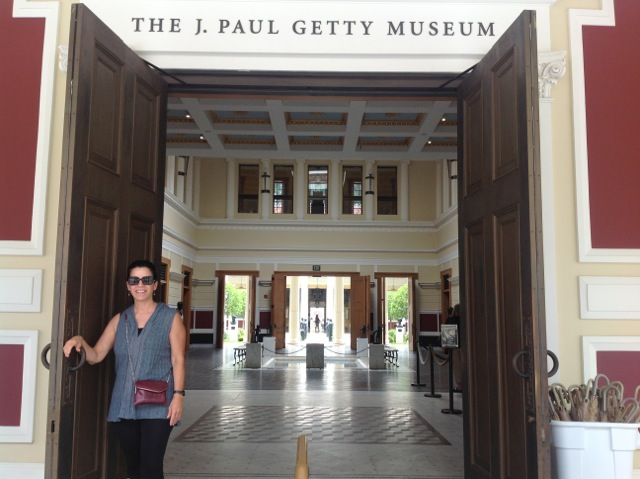 Judy standing aside the Getty Villa Museum entrance