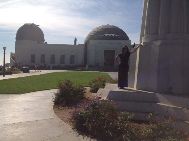 Judy standing next to the Astronomers Monument on Griffith Observatory's front lawn