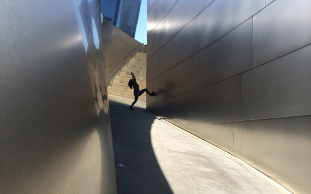 Judy posing at one of Disney Hall's courtyard pathways.
